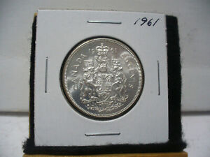 Click now to see the BUY IT NOW Price! 1961  CANADA  SILVER  HALF  DOLLAR  50 CENT PIECE   61    NICE   GRADE