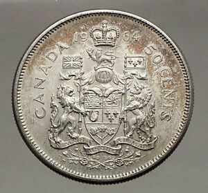 Click now to see the BUY IT NOW Price! 1964 CANADA UNDER QUEEN ELIZABETH II SILVER 50 CENTS CANADIAN COIN ARMS I56631