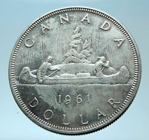 Click now to see the BUY IT NOW Price! 1962 CANADA W UK QUEEN ELIZABETH II VOYAGERS GENUINE SILVER DOLLAR COIN I77911