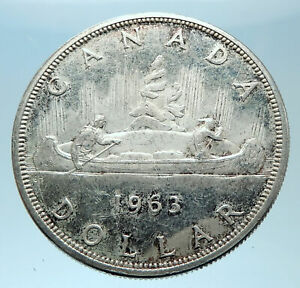 Click now to see the BUY IT NOW Price! 1963 CANADA W UK QUEEN ELIZABETH II VOYAGERS GENUINE SILVER DOLLAR COIN I77913