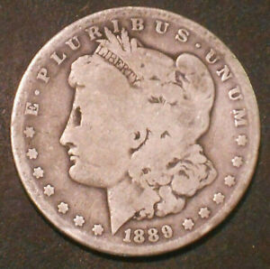 1889 O $1 MORGAN SILVER DOLLAR.