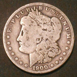 1900 O $1 MORGAN SILVER DOLLAR.