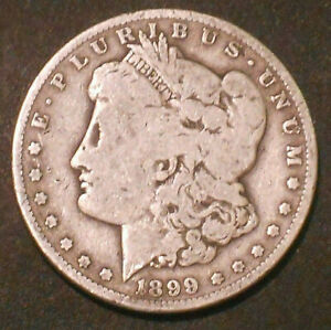 1899 O $1 MORGAN SILVER DOLLAR.