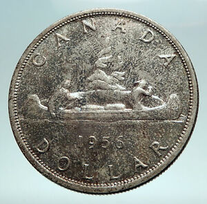 Click now to see the BUY IT NOW Price! 1956 CANADA W UK QUEEN ELIZABETH II VOYAGERS GENUINE SILVER DOLLAR COIN I82562