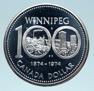 Click now to see the BUY IT NOW Price! 1974 CANADA QUEEN ELIZABETH II WINNIPEG PAST / PRESENT SILVER DOLLAR COIN I83106