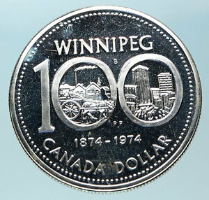 Click now to see the BUY IT NOW Price! 1974 CANADA QUEEN ELIZABETH II WINNIPEG PAST / PRESENT SILVER DOLLAR COIN I83775