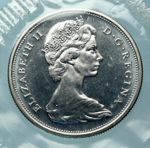 Click now to see the BUY IT NOW Price! 1966 CANADA UK QUEEN ELIZABETH II UNICORN ANTIQUE SILVER 50 CENTS COIN I83875
