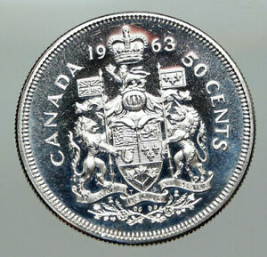 Click now to see the BUY IT NOW Price! 1963 CANADA QUEEN ELIZABETH II ARMS OLD PROOF LIKE SILVER 50 CENTS COIN I85074