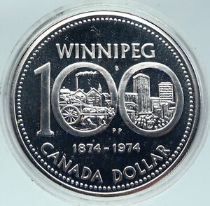Click now to see the BUY IT NOW Price! 1974 CANADA QUEEN ELIZABETH II WINNIPEG PAST / PRESENT SILVER DOLLAR COIN I86327