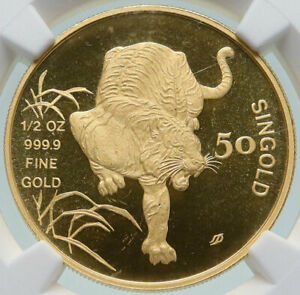 Click now to see the BUY IT NOW Price! 1986 SM SINGAPORE LUNAR SERIES   TIGER VINTAGE GOLD 50 SINGOLD COIN NGC I86540