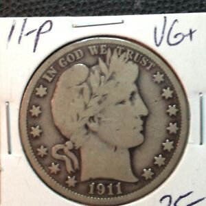 1911 P  VG    BARBER HALF DOLLAR   LITY AND A BIT OF BR