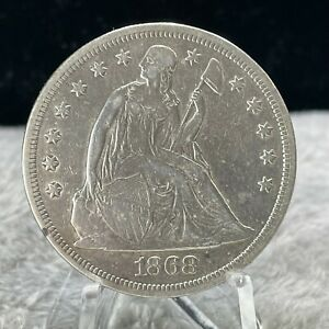 1868 SILVER SEATED LIBERTY DOLLAR COIN BETTER DATE CLEANED