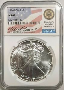 1986 SILVER EAGLE NGC MS 69 MILES STANDISH SIGNED FLAG LABEL