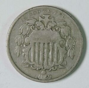 1869 U.S. SHIELD NICKEL TYPE COIN WITH LAMINATION ERROR OVER DATE