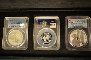 Click now to see the BUY IT NOW Price!  LOT OF 4  NEW YORK: 2001 S SILVER PCGS PR 69 QUARTER AND 2011 9 11 SEE DESCRIPT