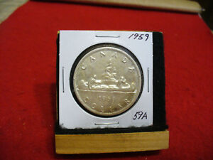 Click now to see the BUY IT NOW Price! 1959  CANADA  SILVER DOLLAR  COIN   NICE GRADE  SEE PHOTOS   59A  SEE PHOTOS