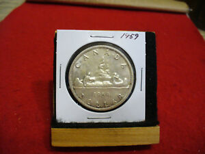 Click now to see the BUY IT NOW Price! 1959  CANADA  SILVER DOLLAR  COIN   NICE GRADE  SEE PHOTOS   59  SEE PHOTOS
