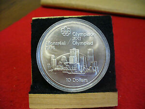 Click now to see the BUY IT NOW Price! 1976 MONTREAL OLYMPICS SILVER 10$ COIN CANADA  MONTREAL SKYLINE  B.U.