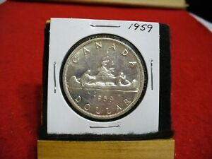 Click now to see the BUY IT NOW Price! 1959  CANADA  SILVER DOLLAR  COIN   NICE GRADE  SEE PHOTOS   59  NICE GRADE