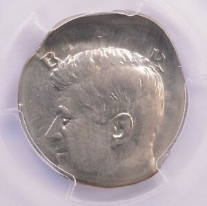 Click now to see the BUY IT NOW Price! PCGS 50C KENNEDY HALF ON DIME PLANCHET & BROCKAGE REVERSE MS 63