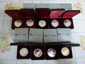Click now to see the BUY IT NOW Price! BIG  LOT OF 9  1980 1988  CANADA  SILVER  DOLLARS  COINS    HIGH GRADES