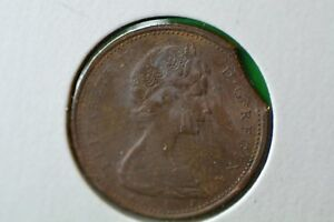 CANADA 1 CENT 1976 AU MY OPINION  CLIPPED PLANCHET  AND COLLECTABLE.