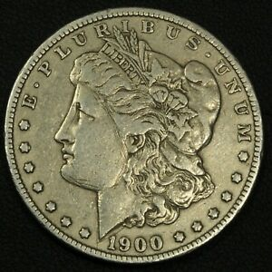 Click now to see the BUY IT NOW Price! 1900 O/CC MORGAN SILVER DOLLAR   SCRATCHES