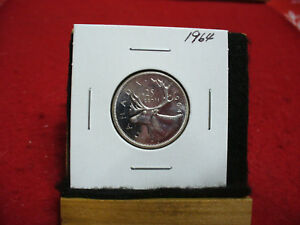 Click now to see the BUY IT NOW Price! 1964  CANADA  SILVER QUARTER  DOLLAR   NICE  GRADE  64 COIN  SEE PHOTOS