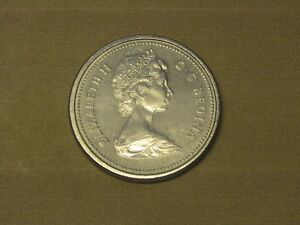 1975 CANADA DOLLAR COIN  ATTACHED VARIETY