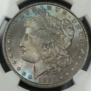 Click now to see the BUY IT NOW Price! 1883 MORGAN SILVER DOLLAR NGC MS 65   BEAUTIFUL OBVERSE BLUE TONING
