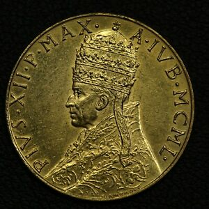 Click now to see the BUY IT NOW Price! MCML  1950  VATICAN CITY PIUS XII 100 LIRE GOLD COIN   LIGHTLY CLEANED