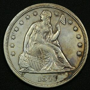 Click now to see the BUY IT NOW Price! 1847 SEATED LIBERTY SILVER DOLLAR   CLEANED