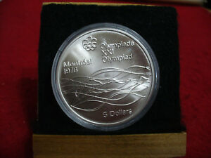 Click now to see the BUY IT NOW Price! 1976   MONTREAL  OLYMPICS   SILVER 5$ COIN   CANADA   SWIMMING   B.U.  STERLING
