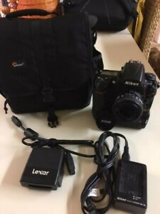 NIKON D D700 12.1MP DIGITAL SLR CAMERA   BODY WITH BATTERY GRIP AND LENS.