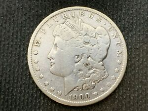1900 O  MORGAN DOLLAR   F VF      3 OR MORE   FREE S/H      90  SILVER    C1124