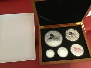 Click now to see the BUY IT NOW Price! 2010 PERTH MINT LUNAR TIGER. 0.5OZ   10OZ  5 COIN SET. 18.5OZS .999 SILVER.