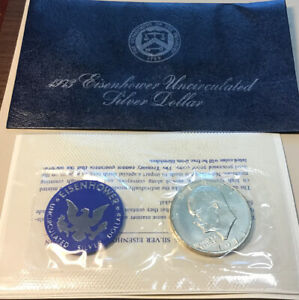 1973 EISENHOWER UNCIRCULATED SILVER DOLLAR IN BLUE ENVELOPE 40  SILVER