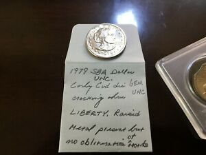 2000 10 15  LARGE CLIP SACAGAWEA DOLLAR   1979 SBA DOLLAR EARLY CUD RAISED METAL