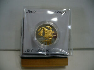 Click now to see the BUY IT NOW Price! 2004  EASTER LILY  50 CENT   STERLING SILVER COIN  .925 SILVER  SEALED COIN