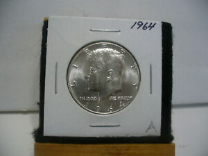 Click now to see the BUY IT NOW Price! 1964   KENNEDY   HALF  DOLLAR  50 CENT PIECE  COIN   64A   NICE  GRADE