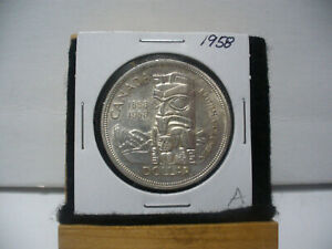 Click now to see the BUY IT NOW Price! 1958  CANADA  SILVER DOLLAR  COIN   NICE GRADE  SEE PHOTOS   58A  NICE GRADE
