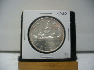 Click now to see the BUY IT NOW Price! 1960  CANADA  SILVER DOLLAR  COIN  1$  NICE GRADE  SEE PHOTOS   60B  NICE GRADE