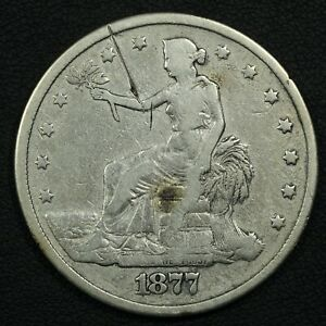 1877 TRADE SILVER DOLLAR   CLEANED & SCRATCHED