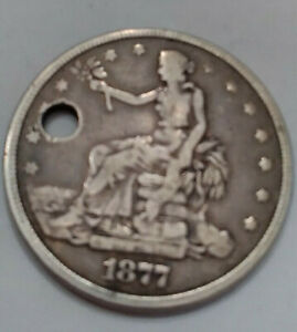 1877 TRADE DOLLAR SILVER DOLLAR WITH HOLE IN IT