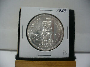 Click now to see the BUY IT NOW Price! 1958  CANADA  SILVER DOLLAR  COIN   NICE GRADE  SEE PHOTOS   58B  NICE GRADE