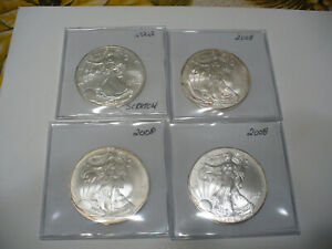 Click now to see the BUY IT NOW Price! LOT OF 4  USA ONE  1 $ DOLLAR   SILVER EAGLE  COINS   PIECES   .999  LOT A  4 OZ