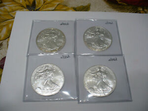 Click now to see the BUY IT NOW Price! LOT OF 4  USA ONE  1 $ DOLLAR   SILVER EAGLE  COINS   PIECES   .999  LOT B  4 OZ