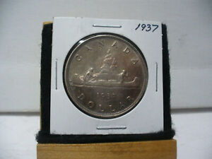 Click now to see the BUY IT NOW Price! 1937  CANADA  SILVER    DOLLAR   ONE   1 $  GOOD   GRADE    37   SEE PHOTOS
