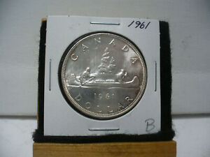 Click now to see the BUY IT NOW Price! 1961  CANADA  SILVER DOLLAR  COIN   NICE GRADE  SEE PHOTOS   61B  NICE GRADE