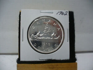 Click now to see the BUY IT NOW Price! 1962  CANADA  SILVER DOLLAR  COIN   NICE GRADE  SEE PHOTOS   62  NICE GRADE
